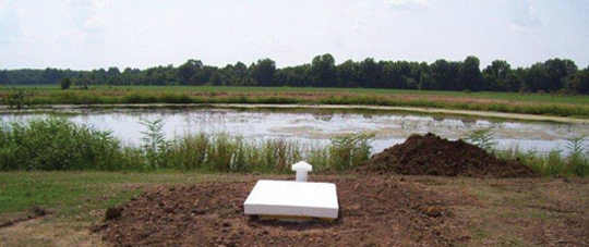 Installed Storm Shelter by a lake